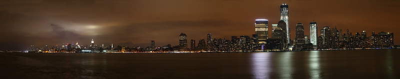 Panoramic view of manhattan seen from the Jersey City waterfront.This panoramic photo is very, very large.  Be sure to zoom in to see the detail of the buildings.