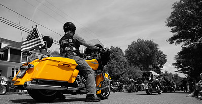 From the 2014 Falls Church Memorial Day Parade, the original is also around in the gallery. Using Pixelmator, I masked out all but the yellow of the motorcycle to create a striking contrast between it and the rest of the scene.