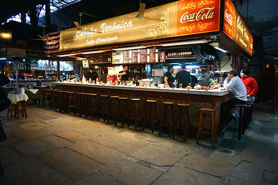 This is one of the many restaurants tucked into the Mercado del Puerto (Market of the Port) in Montevideo, Uruguay. I can't really explain why I like this picture, but I do.