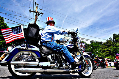 From the 2014 Falls Church Memorial Day Parade, the unaltered version of this photograph is in the gallery as well. But the saturation and shadow boost, especially on the riders shirt, gives this picture a little more edge in my opinion. As with many of my pictures from this parade, it would be nice if the city of Falls Church could burry their power lines. It would give us photogs some better shots.