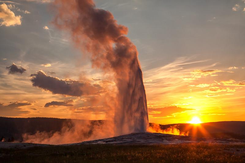 Old Faithful at sunset. Yellowstone National Park, Wyoming
