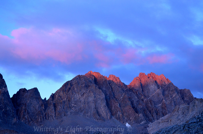 Alpenglow on Starlight Peak and North Palisade Peak from Upper Dusy Basin lakes.