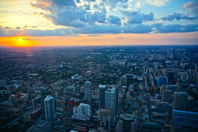 This is the Toronto, ON, Canada city-scape at sunset taken from the CN Tower. The glass of the tower has many smudge-prints and collects glare from the tower's light effects, so getting good shots isn't as easy as you would think. Of the 200 pictures I took, I kept only 3 this one being the best.