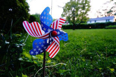 Nothing more than a camera test taken on the doorstep of my house, I still like this patriotic pinwheel set against a green, Virginia lawn.