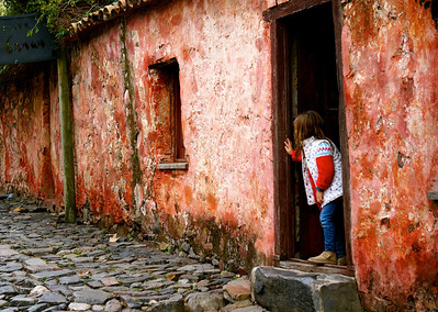 Taken on a street famous for its color in Colonia del Sacramento, Uruguay, I like that this little girl is looking down the street at something out of the shot. It leaves you wondering what has captured her attention.