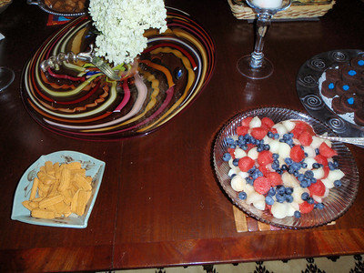 Cheese straws and melon balls w/ blueberries.