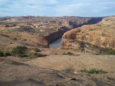 The mighty Colorado River , note the two cyclists in the distance.