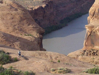 Slick Rock Trail looking over the Colorado River. When we caught up to the two cyclists in the distance they were very lost and low on water. We gave them directions and some water.