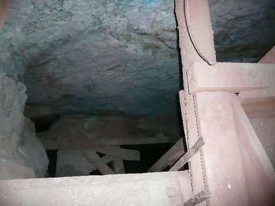 about 100 feet in the tunnel has a vertical shaft that is flooded about 20 feet below, the tunnel makes a 90 degree right