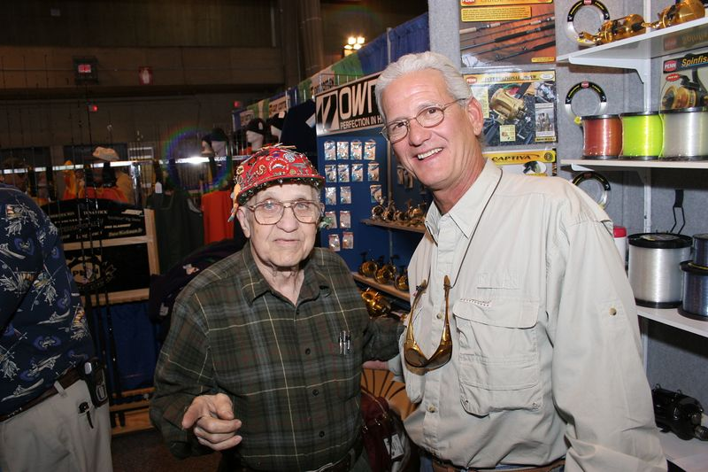 "<p>I stopped by the <a href=""http://www.pennreels.com""> Penn</a> booth and talked to Tom.  He was wearing his famous cap which is covered with pins of all sorts.  Tom is an expert reel repair man and loves to fish.  He also constructs specialty fishing lures and rigs and has the worlds one and only fishing reel handle collection.  He is a lot of fun to talk to and an avid 80 something year old fisherman. </p>"
