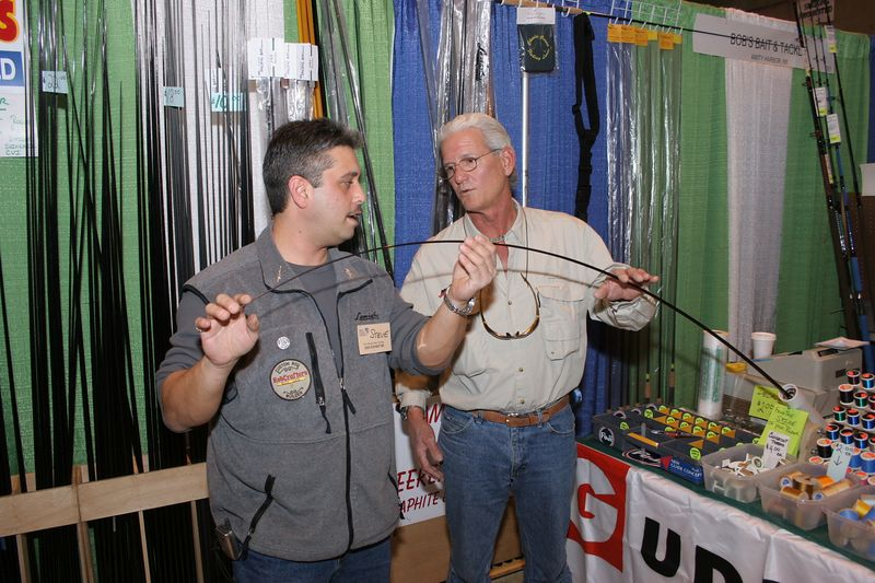 3/4/2004<br /> Tim and I spent the afternoon at the Rockland Outdoor Show in Suffern, NY.  It was a good show with lots of vendors of fishing and hunting gear.<br /> I talked to Steve Petri at the Bob's Bait and Tackle display.  Steve is showing me how to check for the spline in the rod blank so that the guides can be placed properly when the custom rod is wrapped.<br /> <br /> Bob's Bait and Tackle Amity Harbor<br /> Long Island 631-842-7535