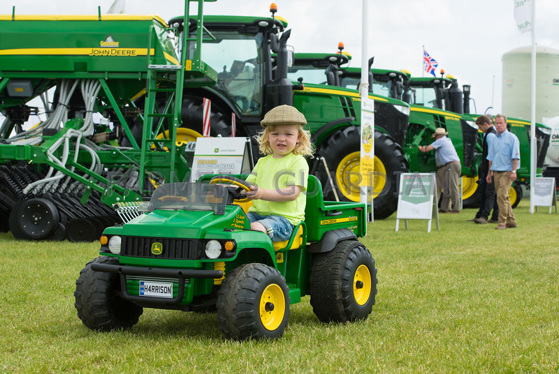 Three year old Harrison Burley from Canterbury with his own transport at Cereals Event, Lincolnshire.