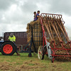 field elevator lifts straw to demonstrate contruction of a hay 'ruck' or 'pike' ./
