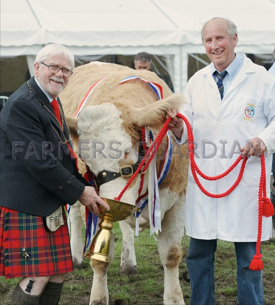 """Provost Dennis Melloy seen presenting The Angus Howie Memorial Trophy at Perth Show to David Craig and his Show Champion """"Kennox Tara's Gem."""