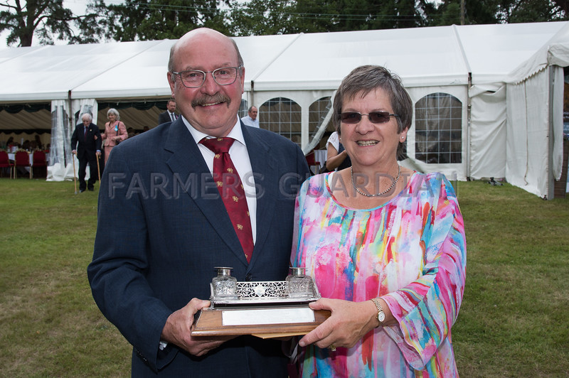 Laurence and Eira Harris with the Sir Bryner Jones memorial award for the person who has made and continues to make an exceptional contribution to the Dairy Industry in Wales.