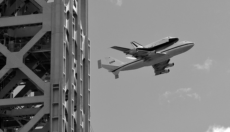 The space shuttle Enterprise atop the NASA 747 transport passes the New Jersey tower of the George Washington Bridge on Friday morning.
