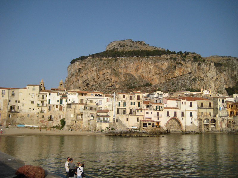Cefalu: founded circa 300-400 BC, later conquered by the Syracusan Greeks (307 BC) and the Arabs (857 BC). Roger II the Norman King refurbished the town in 1131 and constructed the enormous Duomo, which itself is dwarfed by la Rocca