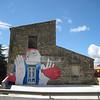 Castellana Sicula, graffiti on a warehouse