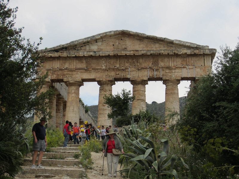 Segesta was the main city of the Elimi, who claimed to be descended from the Trojans, led there by Aeneas. They were at war with Selinunte from 580 BC, and allied with Athens, then Carthage. Later attacked by Syracusans and in 307 BC sacked by Agathocles, who, over the course of three days, catapulted 8,000 - 10,000 of the inhabitants into the ravine below from the flat area behind the temple.