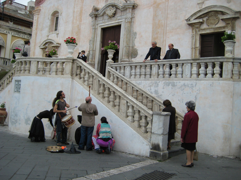 Happy ending. The buskers will wrap up before the church service starts