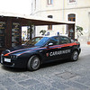 An Alpha Romeo police car (in Palermo the cops have unmarked black BMW's that will roar down the already chaotic streets with flashing lights, sometimes in pairs)