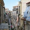 View from hotel la Giara balcony: Via Veterani, looking uptown. The ladies talking across their balconies.