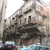 Vucciria Quarter - a small piazza surrounded by more bombed out relics from 1943, with layers of graffiti and posters