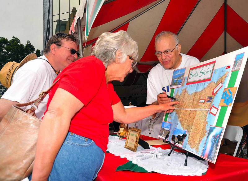 Visitors explore their Sicilian roots at the Sicilian Festival cultural pavilion.
