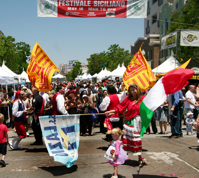 Part of the highlight of the Sicilian Festival is the procession at noon, featuring children carrying flags of various regions of Sicily and Italy.