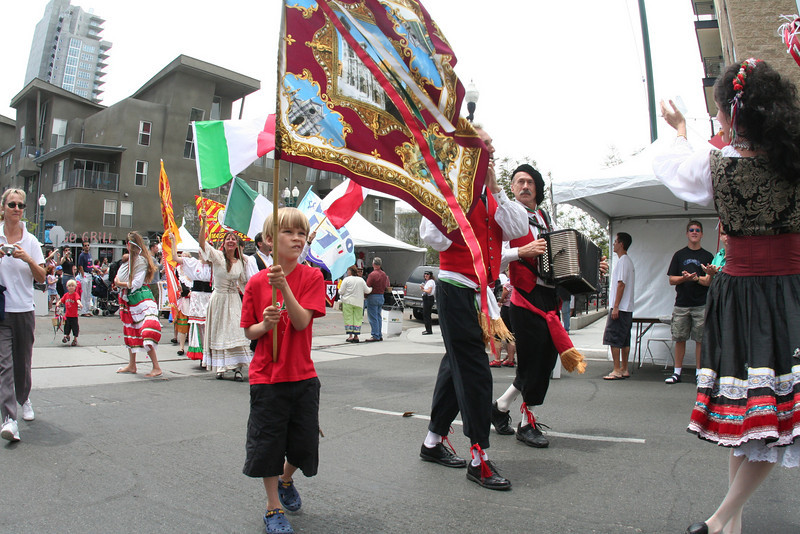 It isn't always fun for kids to carry flags in the traditional procession...sometimes they get tired!