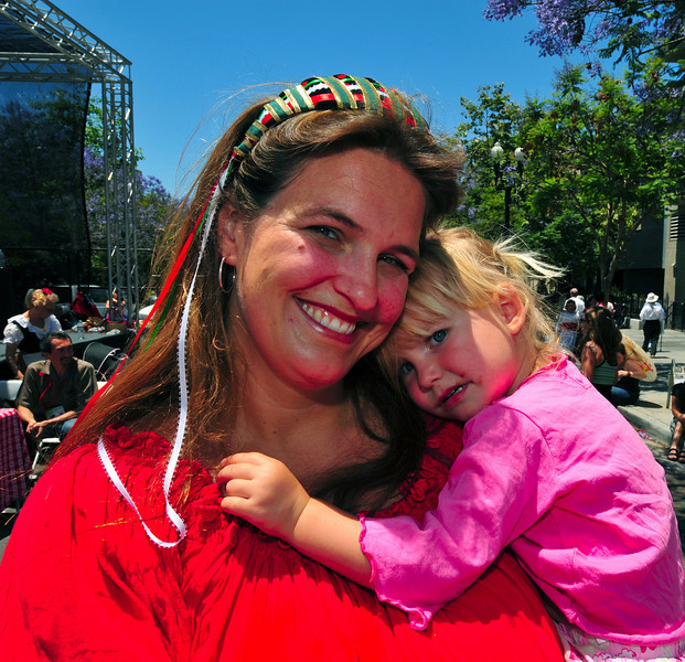 A Sicilian mother consoles her tired Bambina after an exciting day at San Diego's Sicilian Festival.