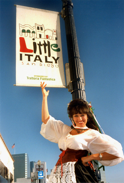Giovanna DiBona, vocalist with the Roman Holiday Ensemble, welcomes visitors to San Diego's traditional, yet urban hip, Little Italy neighborhood in San Diego.