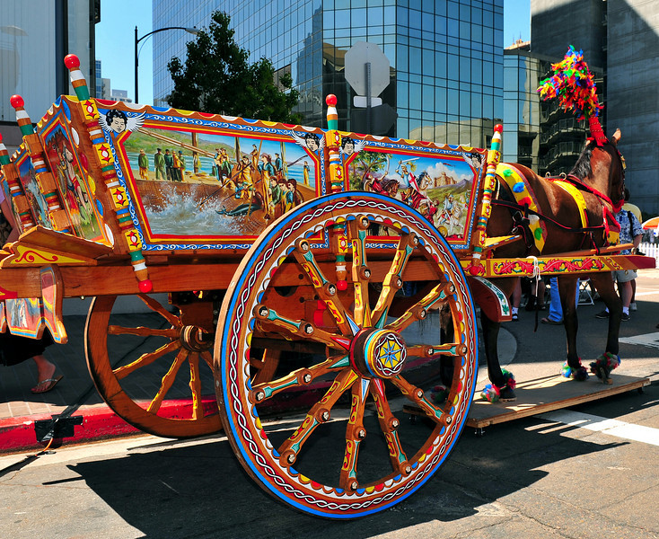 "San Diego's Sicilian Festival features the heritage and culture of Sicily, most prominent of which is the traditional Sicilian cart ""carretta""--hand painted with various scenes and the vivid colors typical of Sicilian artifacts."