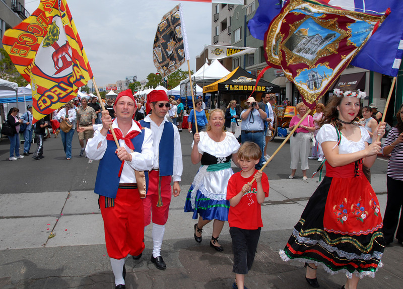 Sicilian costumed dancers lead the procession through the streets of San Diego's Little Italy.