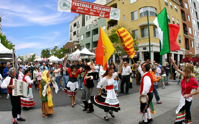 There is plenty of dancing in the streets as part of the colorful Sicilian Festival in the streets of San Diego's Little Italy.