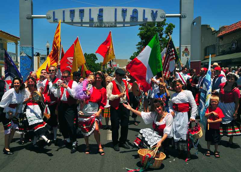 "The Roman Holiday Ensemble ( <a href=""http://www.romanholidaymusic.com"">http://www.romanholidaymusic.com</a>) poses underneath the Little Italy sign in the heart of San Diego's Italian community, during the annual procession of the Festa Siciliana."
