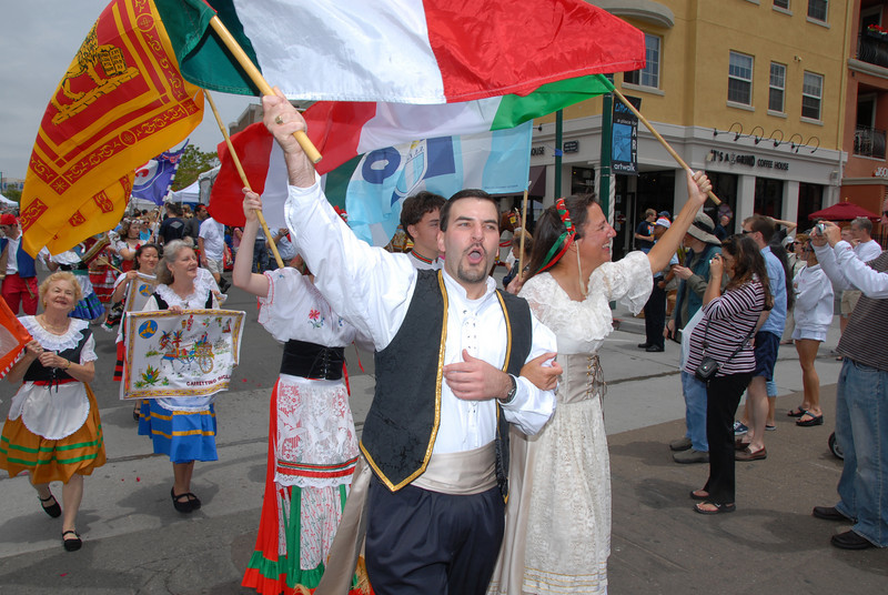 The Sicilian bride and groom, I Sposi, parade through the streets of Little Italy.