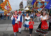 Traditionally-costumed representatives of San Diego's Sicilian community march through the streets as part of the Sicilian Festival procession.