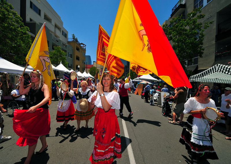 Lovely Sicilian dancers lead the procession that launches the Sicilian Festival in San Diego.