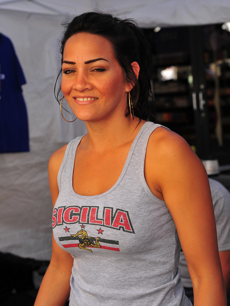 With a smile on her face, this lovely lady sells a wide variety of items touting the Sicilian flag and logos.