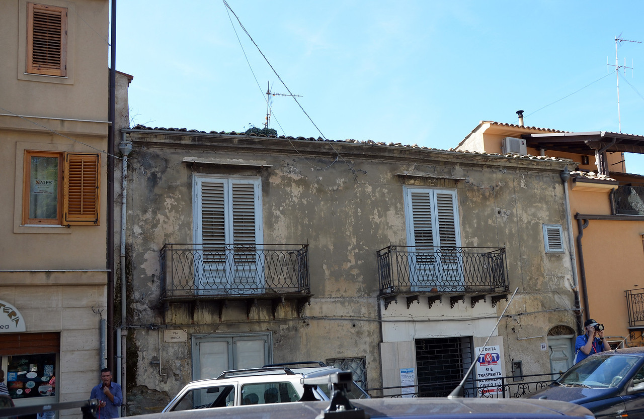 An assassination took place behind the blue shutters and this apartment is never rented.