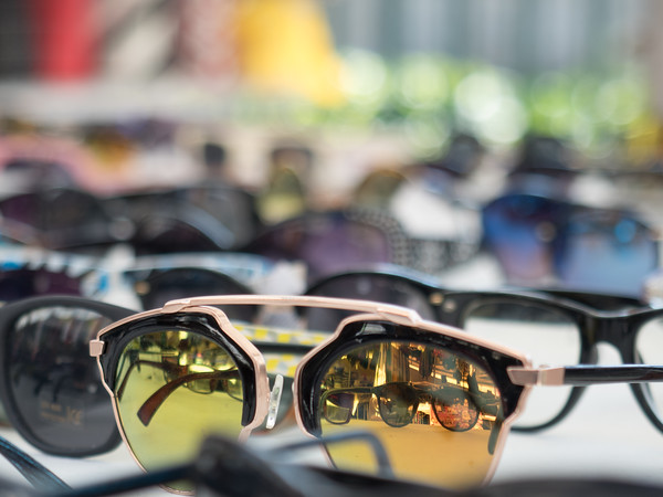 Lots of reflections in sunglasses for sale at a market in Ortygia (Siracusa)