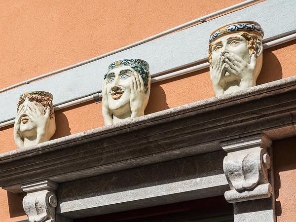 See no evil, hear no evil, speak no evil. Sicilian ceramic head pots, Taormina