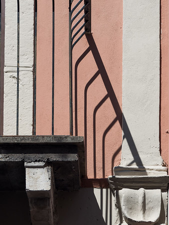 Shadows of patio railings in Taormina