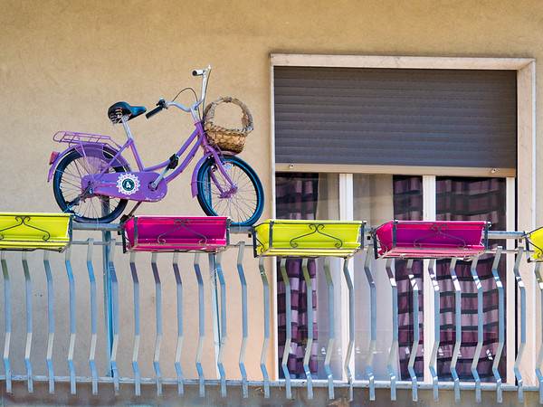Just a bicycle on second floor railing in Randazzo.