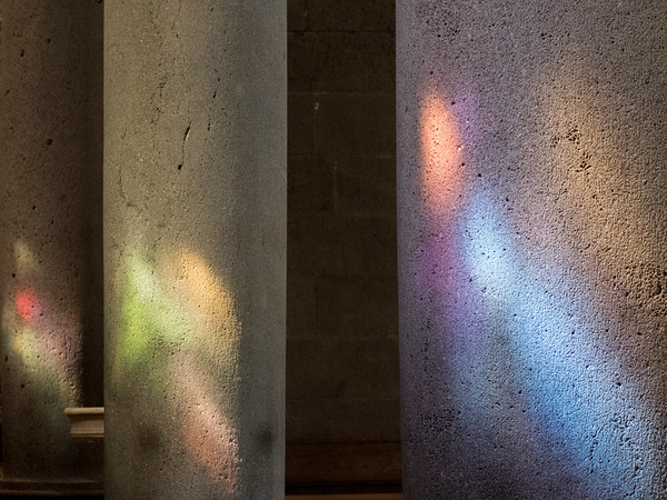 Beautiful light patterns on the walls and pillars from the stained glass windows above.<br /> Santa Maria's Church of Randazzo