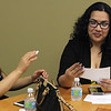 Lynn, Ma. 6-7-17. Yohanna Chalas left, and Odalis Rodrigues, right, practice their presentation in English prior to the start of the student recognition ceremony for employees who completed the workplace based English classes at Sidekim Foods in Lynn.