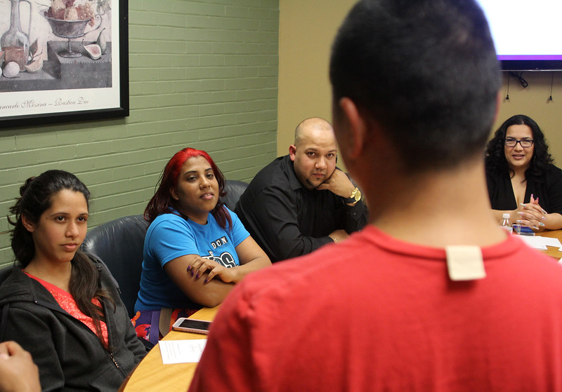 Lynn, Ma. 6-7-17. Candida Silva Rodriguez, Anyeli Garcia, Carlos Pacheco, and Odalis Rodrigues listen to fellow student and employee Santa Mongar give his brief  presentation in English during the student recognition ceremony for Sidekim Food employees who took workplace based Englsih clases.