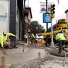 Workers from McIver Bros. out of Lexington work on putting in a sidewalk at the corner of West and Main streets on Friday afternoon in Leominster. SENTINEL & ENTERPRISE/JOHN LOVE