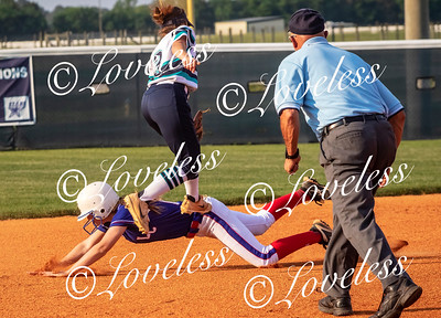 Siegel's Vanessa Westfall tags the Lincoln County runner out at second. JIM DAVIS
